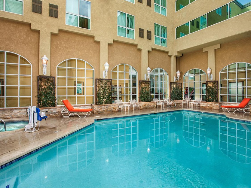 Outdoor Pool & Hot Tub at Desert Palms Hotel and Suites in Anaheim